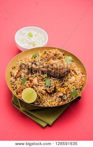 chicken biryani with leg piece, a favourite non veg dish in india poster