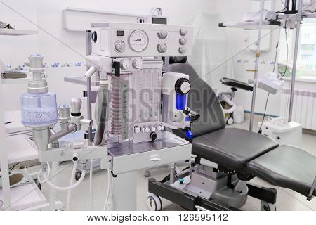interior of the operating room in dental clinic with the anesthesiology machine on the frontground