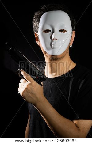 Man In A Mask With A Gun