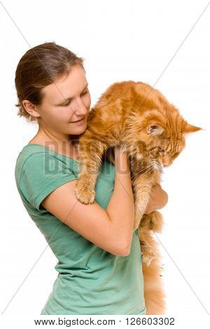 Woman holding cat, maine coon kitten 9 months old, isolated over white