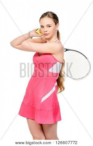 Portrait of a girl tennis player in motion. Studio shot. Isolated over white. Professional sports, tennis.