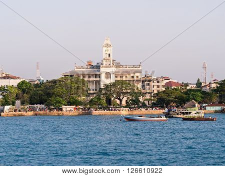 STONE TOWN ZANZIBAR - MARCH 29 2016: Stone Town on Zanzibar with House of Wonders seen from the ferry from Dar es Salaam.