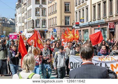 STRASBOURG FRANCE - APR 20 2016: Man looking at protest as hundreds of people demonstrate as part of nationwide day of protest against proposed labor reforms by Socialist Government