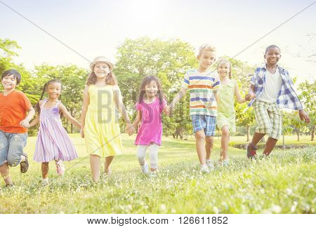 Grown Up Children Playing Sunshine Day in Park Concept