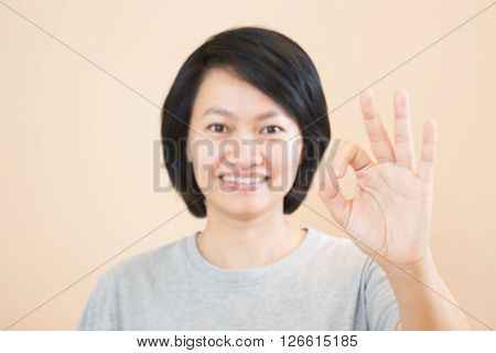 Asian woman hand action gesture stock photo ** Note: Soft Focus at 100%, best at smaller sizes