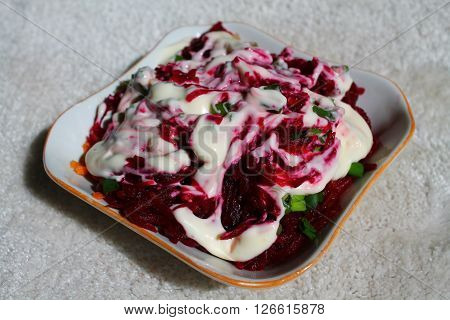 appetizing colorful vegetarian light salad from fresh young juicy beet under souce