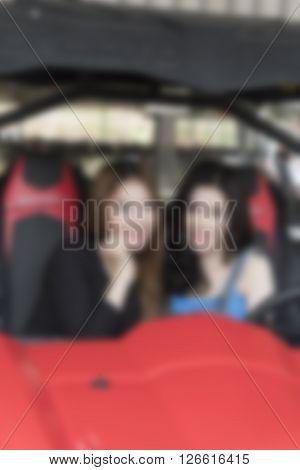 Woman At Indoor Go-cart Stadium, Blur And Defocused