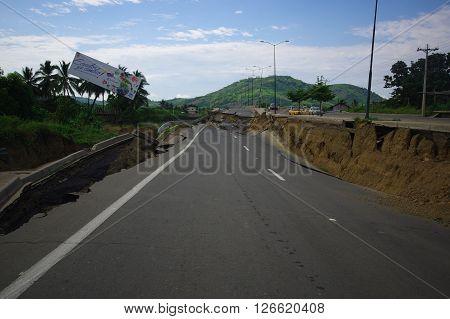 Portoviejo, Ecuador - April, 18, 2016: Cracked road after devastating 7.8 earthquake