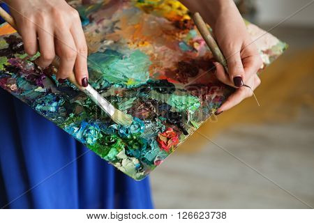 Artist Brush Mix Color Oil Painting On Palette Is Holding In Her Hand Closeup