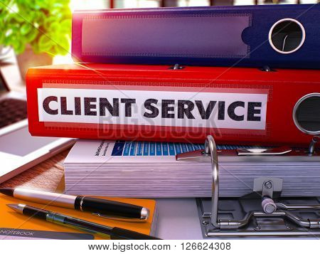 Red Office Folder with Inscription Client Service on Office Desktop with Office Supplies and Modern Laptop. Client Service Business Concept on Blurred Background. Client Service - Toned Image. 3D.