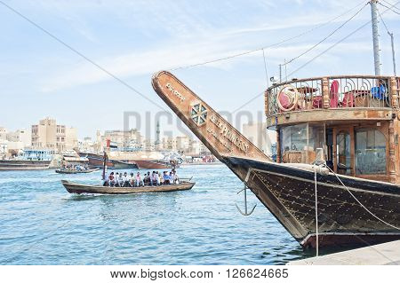 Dubai ,United Arab Emirates - April 7 2016 : Traditional Abra (water taxi) crossing the Dubai Creek between Deira and Bur Dubai