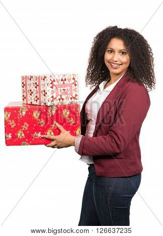Cut out image of a young woman who is holding christmas presents.