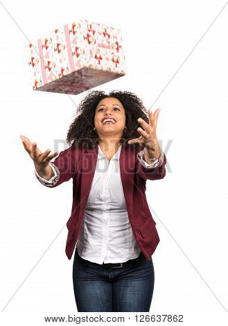 Cut out image of a young woman who is catching a christmas present.