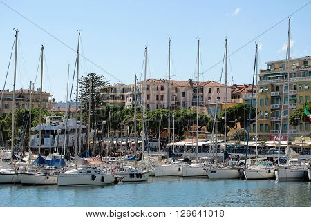 Monte Carlo Monaco - September 21 2015: luxury sailing boats yachts at moorage in sea port inshore on summer day on cityscape background