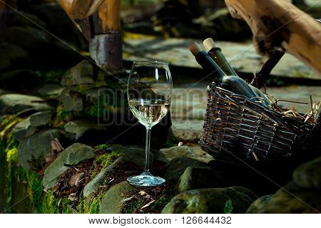 Wine Glass Near Bottles In Basket