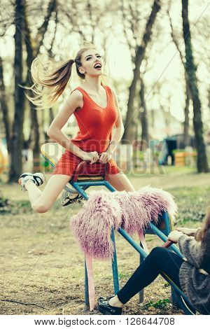 Playful Woman On Swing