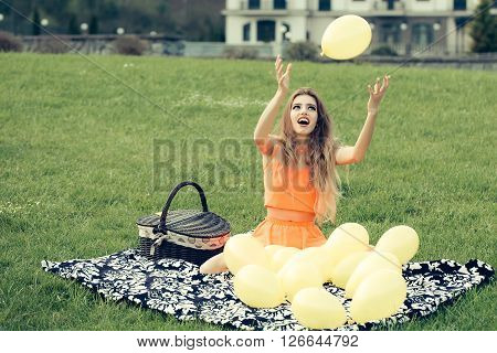 Woman On Picnic With Balloons