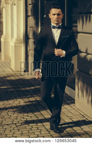 Man Walks With Serious Look