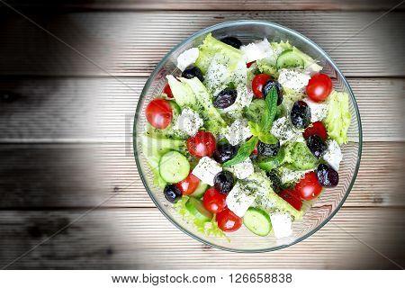 Fresh Greek Salad on a wooden background