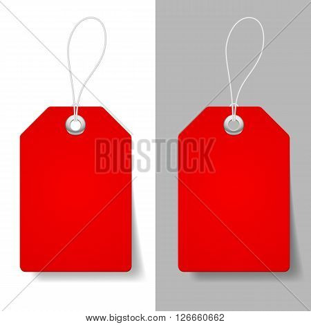 Blank red price tags on white and grey background