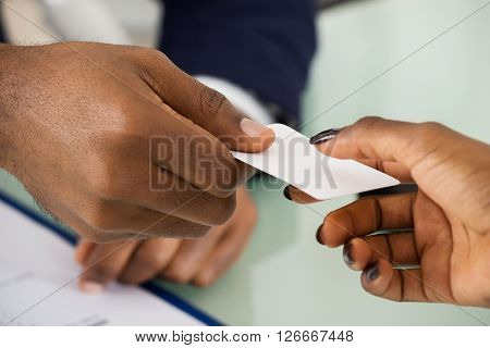 Businesspeople Exchanging Name Card