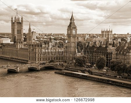 Cityscape from London Eye with houses of Parliament Big Ben and Westminster Abbey with sepia effect. London. UK