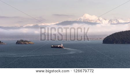 An Oil Tanker makes it way towards the sea from Anacortes WA