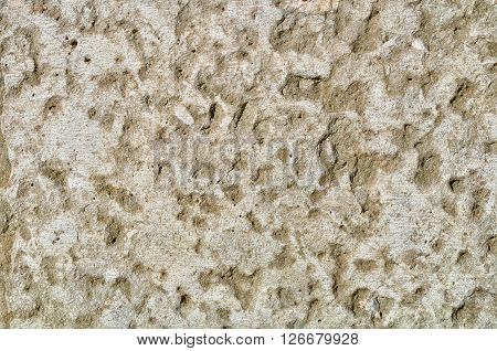 Beige stone wall texture with fine grooves - rough textured background.