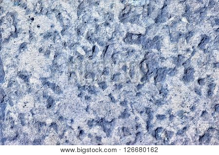 Pale blue stone wall texture with fine grooves - industrial textured background.