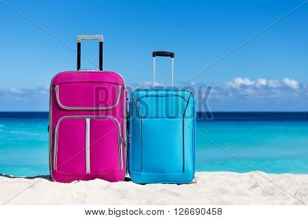 Two Suitcases On Sandy Tropical Beach