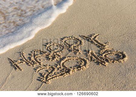 Inscription Happy 2016 On Sandy Beach With Wave's Foam
