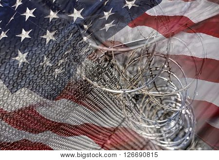 USA Border fence barb razor wire with American Flag Immigration Concept photograph