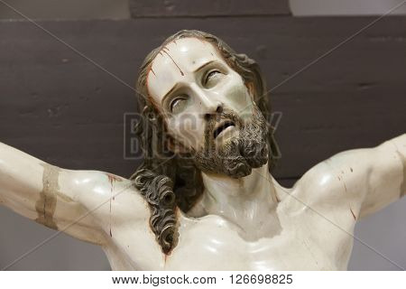 Christ crucified, wood carving, plaster and painted