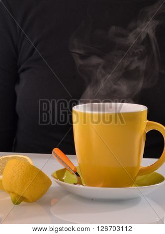 Hot lemonade tea cup and lemon.