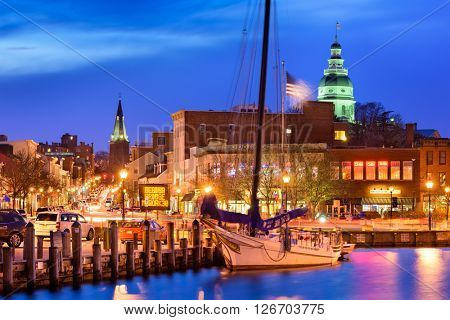 ANNAPOLIS, MARYLAND - APRIL 1, 2015: The harbor of Annapolis at dusk. The city is the capital of Maryland.