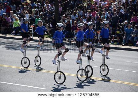WASHINGTON, DC - APR 16: Unicyclists at the 2016 National Cherry Blossom Parade in Washington DC, as seen on April 16, 2016. Thousands of visitors gathered to attend this annual event.