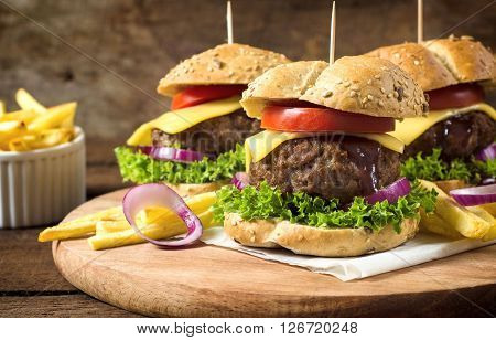 Juicy beef burgers with melted cheese with sesame buns