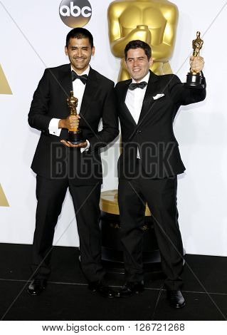 Gabriel Osorio Vargas and Pato Escala Pierart at the 88th Annual Academy Awards - Press Room held at the Loews Hotel in Hollywood, USA on February 28, 2016.