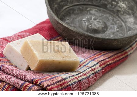 Traditional Turkish bath objects bath bowl, soap and pestemal.