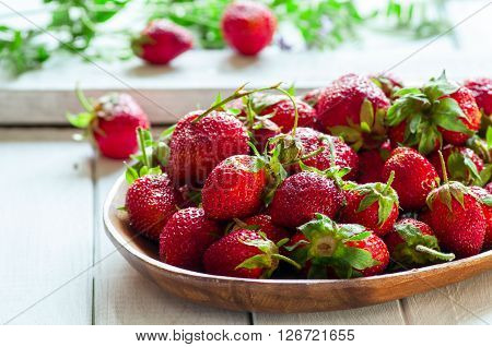 Fresh organic strawberry on wooden background selective focus horizontal