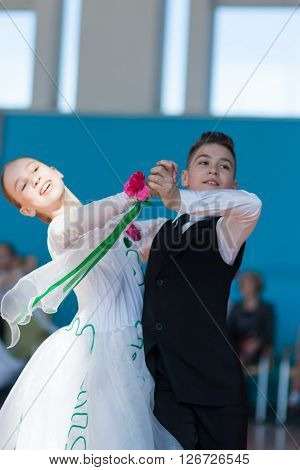 Minsk Belarus -April 3 2016: Panasyuk Maksim and Belyankina Liana Perform Juvenile-1 Standard Program on the IDSA Championship Kinezis Star Cup - 2016 in April 3 2016 in Minsk Republic of Belarus
