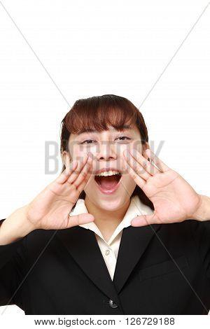 Asian businesswoman shout something on white background