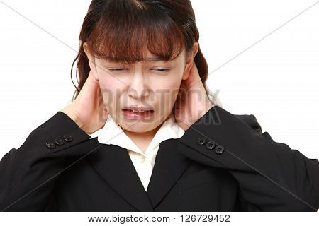 Asian businesswoman suffers from neck ache on white background