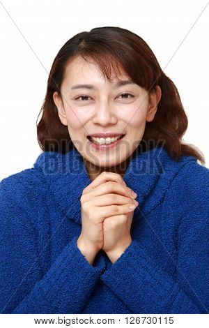 studio shot of Asian woman pleased on white background