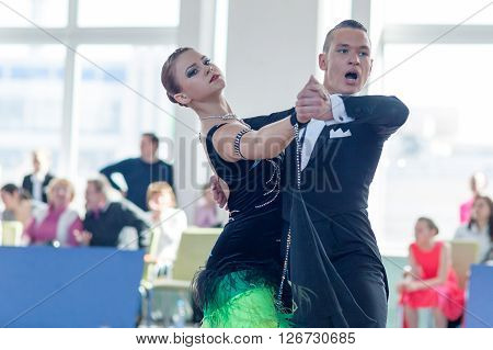 Minsk Belarus -April 3 2016: Puschin Aleksei and Makovskaya Valeriya Perform Youth-2 Standard Program on the IDSA Championship Kinezis Star Cup - 2016 in April 3 2016 in Minsk Republic of Belarus