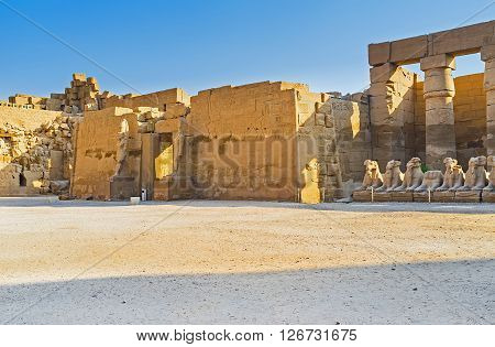 LUXOR EGYPT - OCTOBER 7 2014: Two stone statues in front of the entrance of the Temple of Ramesses III located in Karnak Complex on October 7 in Luxor.