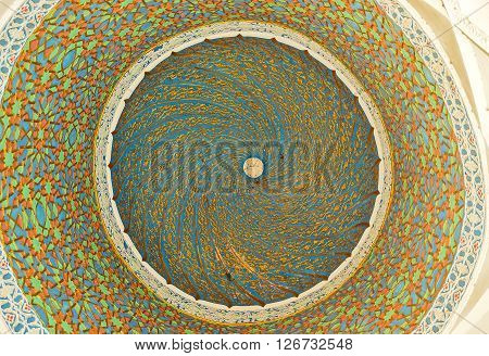 KOKAND UZBEKISTAN - MAY 6 2015: The spiral curved pattern on the cupola of the Norbut-biy Madrasah made of gilt arabesques on May 6 in Kokand.
