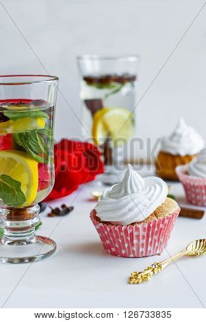 Homemade Muffins With Cream And Tea With Lemon And Mint