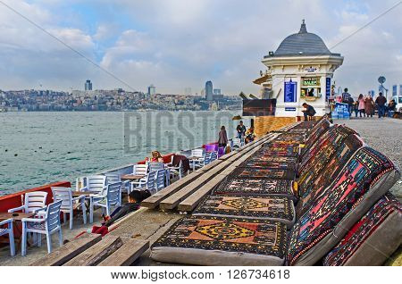 ISTANBUL TURKEY - JANUARY 21 2015: The traditional Turkish lounges in the outdoor teahouse located on Uskudar embankment on January 21 in Istanbul.