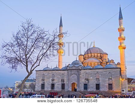 ISTANBUL TURKEY - JANUARY 21 2015: The Yeni Cami (New Mosque) with brightly illuminated minarets on January 21 in Istanbul.